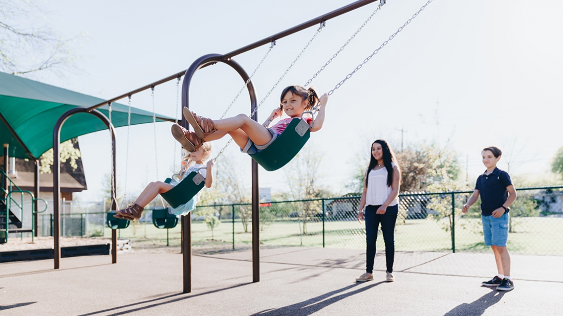 children on swings texas