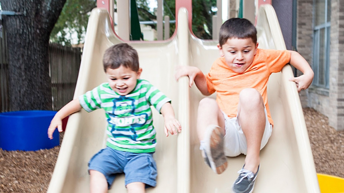 boys playing on slide